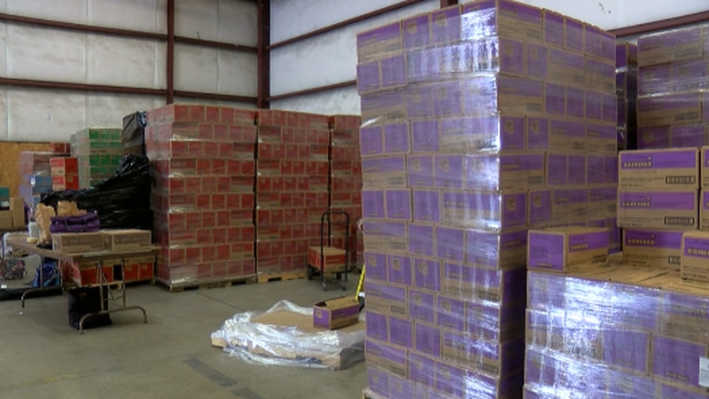 Some of the 15 million boxes unsold Girl Scout cookies produced for the 2021 sale sitting in...