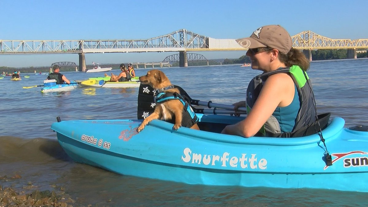 A woman loaded up her furry friend in her kayak during the Hike, Bike and Paddle.