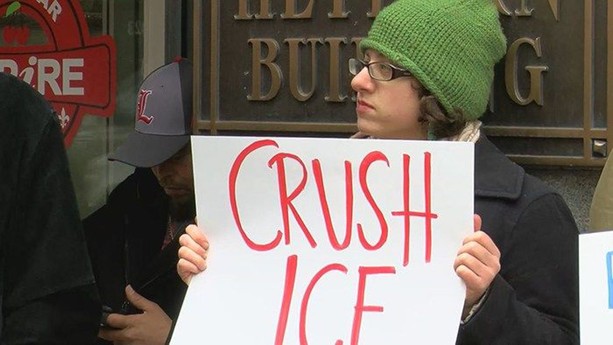 Protesters lined the sidewalks Monday, with signs opposing the opening of the new ICE...