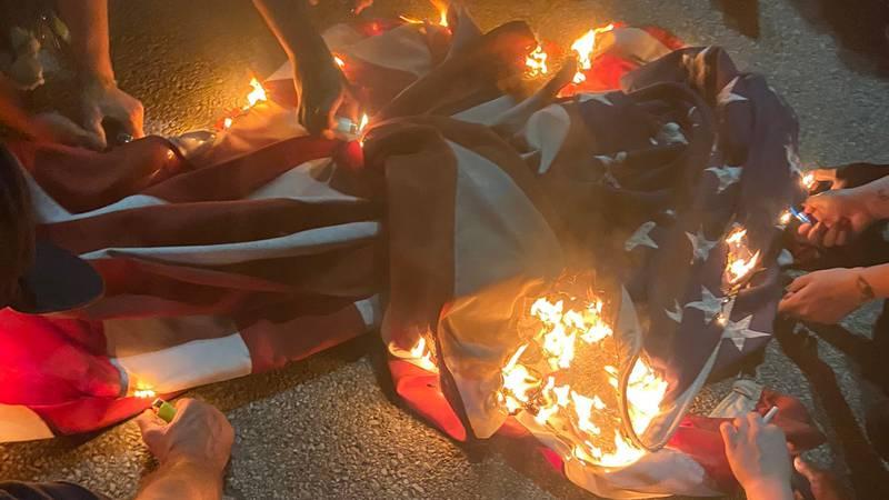 Protesters in Cincinnati set American flag on fire