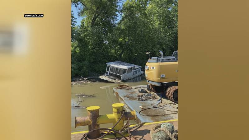 The houseboat was removed Wednesday.