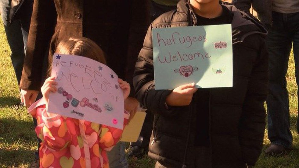 The wife of a soldier at Fort Knox brought her three children to the interfaith rally. (Source:...