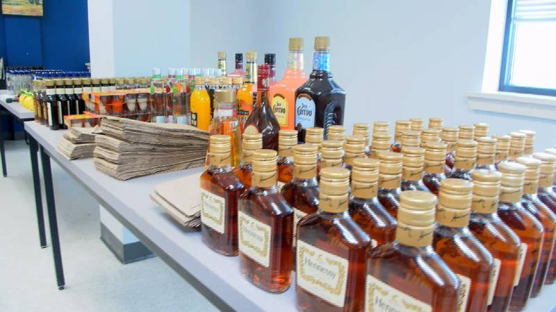 Police seized 320 bottles of liquor from the Laurel home.
