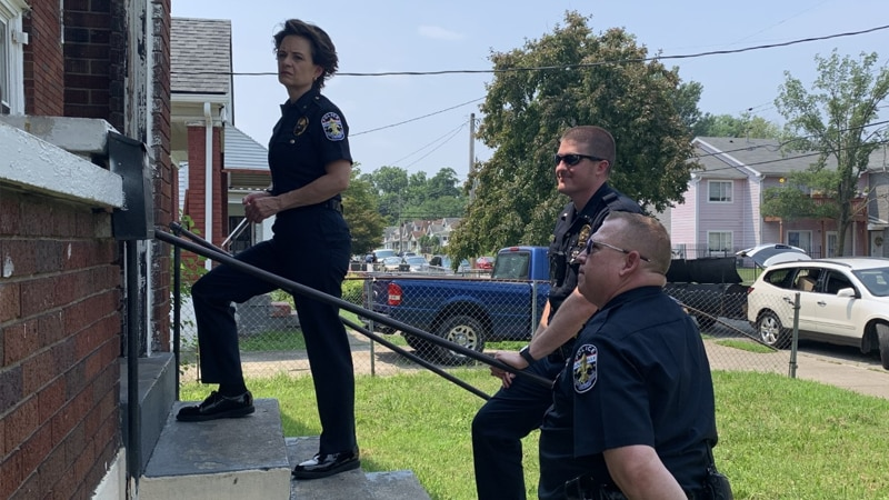 LMPD Chief Erika Shields and other LMPD officers went door-to-door on July 22 on Cecil Avenue...