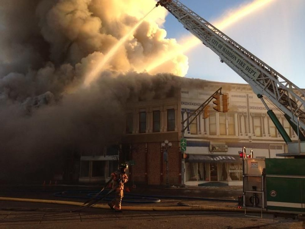 Crews worked throughout the morning to try to put out the fire. (Source: Ron Buchanan)