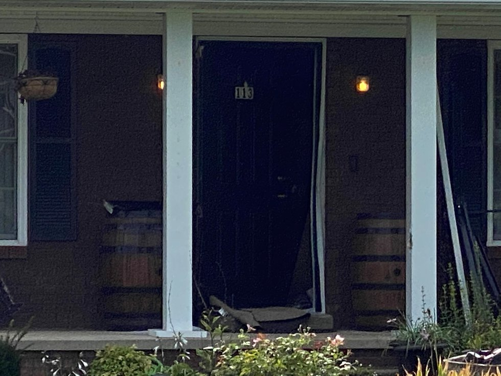 The door at Brooks Houck's house appeared to be damaged Thursday morning.