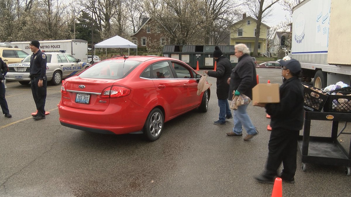 The drive-thru meal program moves to a different community center each weekday