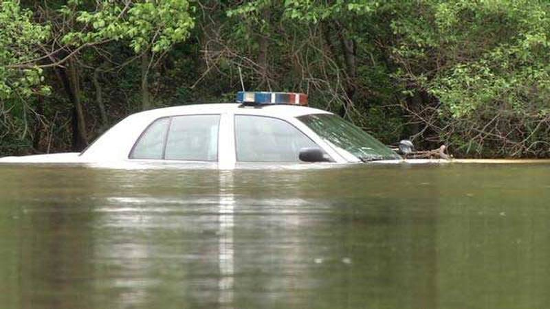 A Louisville Metro Police cruiser caught in rising flood waters in Cherokee Park