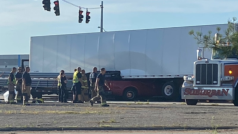 A dually truck driving eastbound on Outer Loop hit a UPS semi-truck and continued under it as...