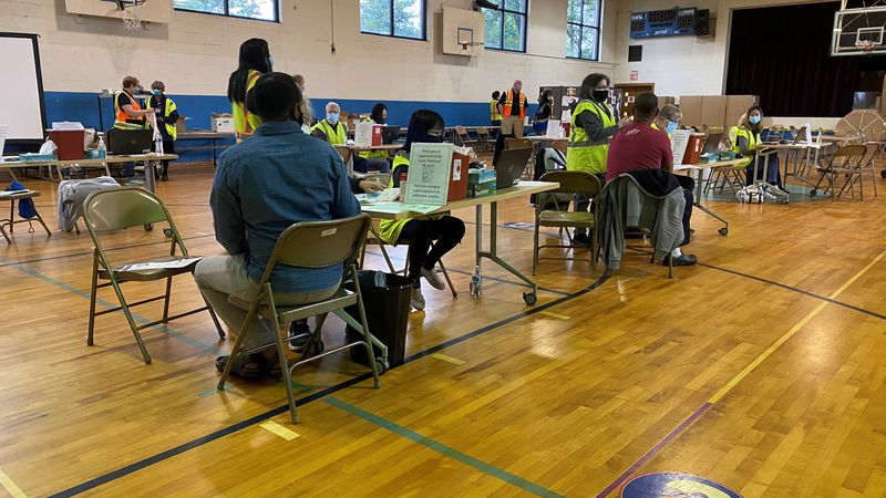 People get vaccinated at Americana Community Center