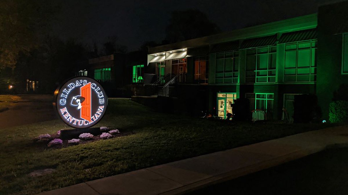Gilda's Club on Grinstead Drive is lit up green to honor victims of the coronavirus.