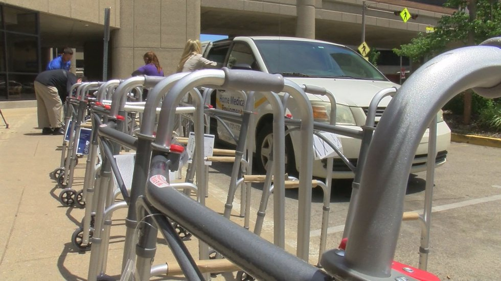 The donation of 20 wheelchairs and 20 walkers to UofL Hospital by Gould's Discount Medical will...