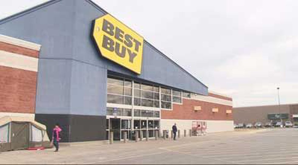 Shoppers walk by people camped out in front of the Best Buy store in Okolona.