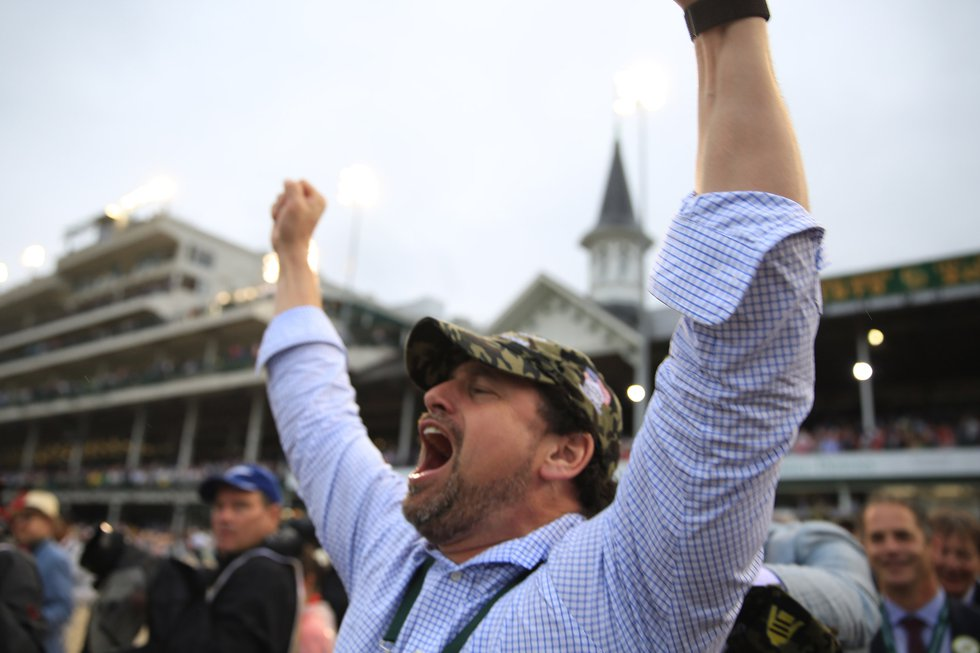Connections to Country House celebrate their horse's controversial win in Saturday's Kentucky...