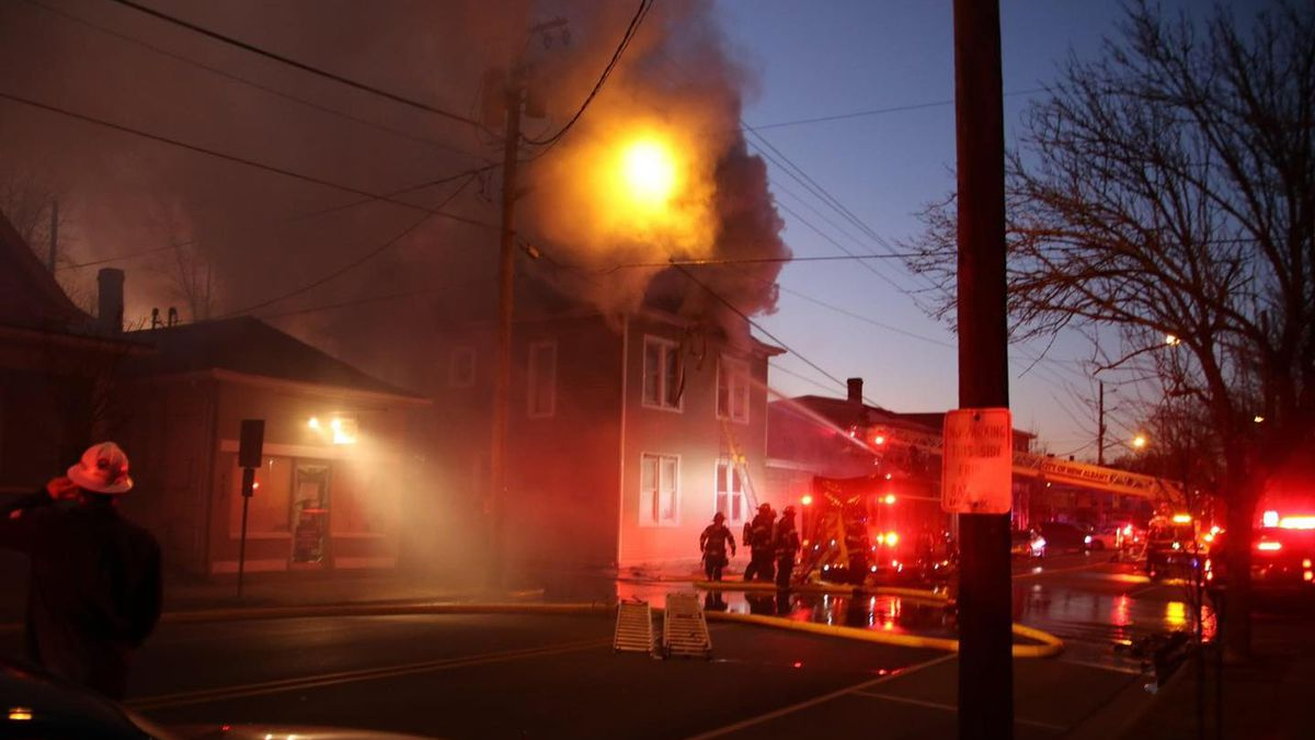 A massive fire in an apartment building Friday night led to crews demolishing the building due...