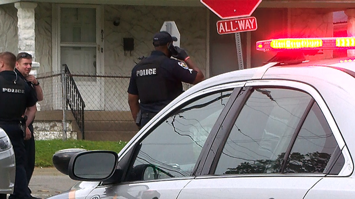 LMPD officers investigating a shooting near Churchill Downs in Taylor Berry on May 10.