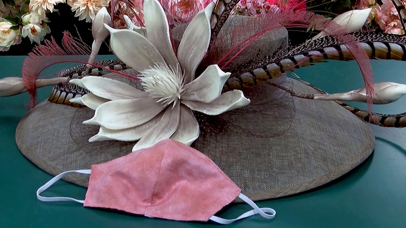A Kentucky Derby hat with matching mask