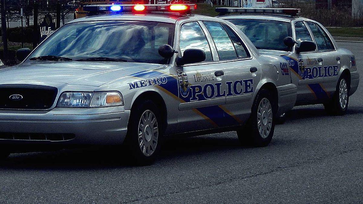 LMPD cruisers at a crime scene