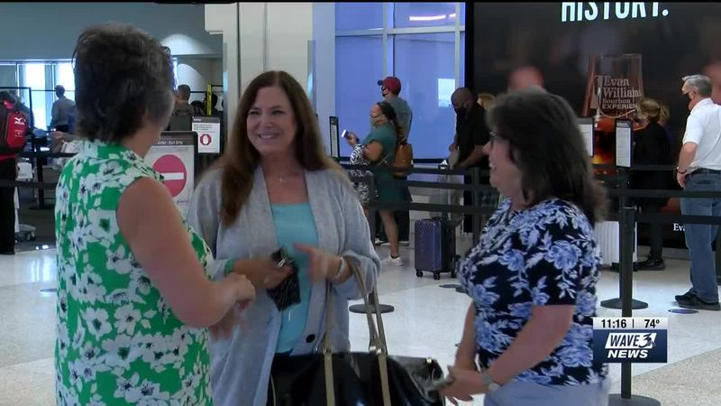 Among the hustle and bustle at Louisville's Muhamad Ali International Airport, a family reunion...