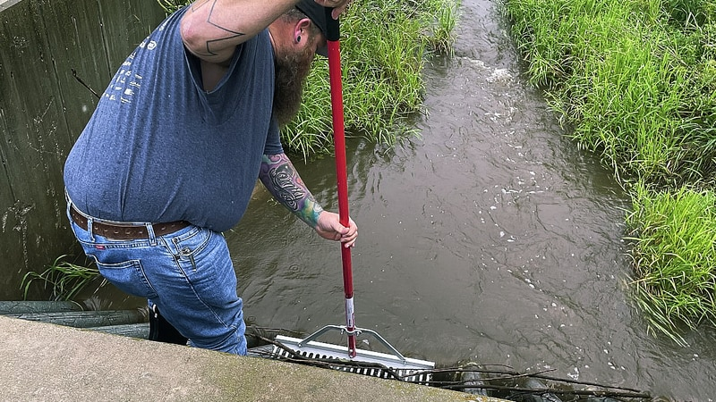 Cleaning out storm drains around homes can help prevent backups, which is exactly what Seymour...
