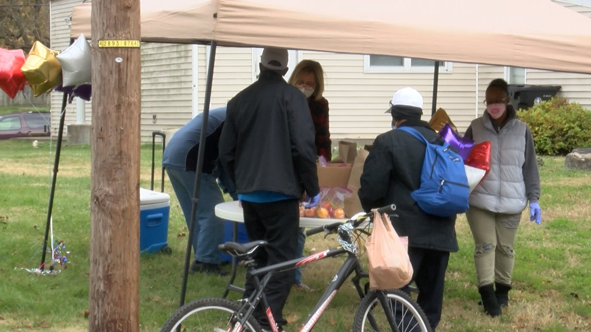 Bags were filled with various canned goods and a fresh chicken, handed out to people driving or...