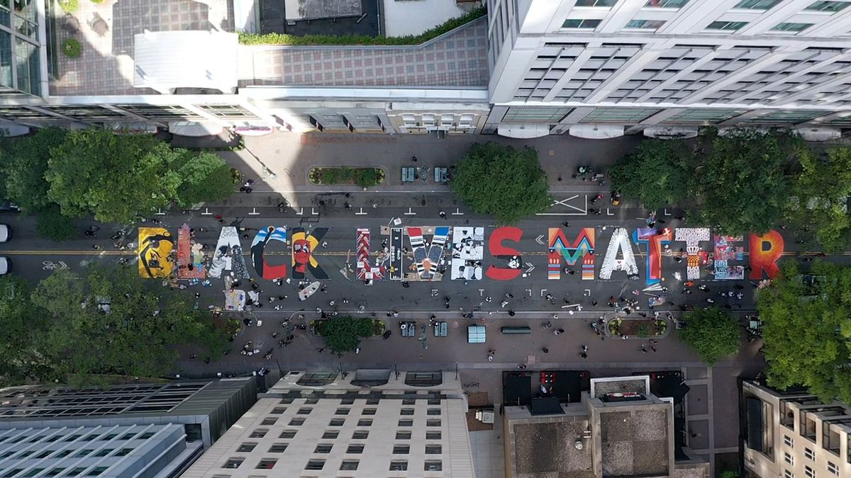 Local artists are creating a Black Lives Matter mural on Tryon Street between Third and Fourth...