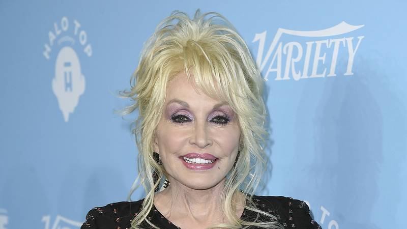 FILE - In this Sept. 15, 2017 file photo, Dolly Parton arrives at the 69th Primetime Emmy...