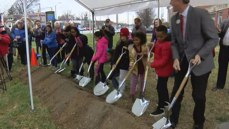 Students who will attend the new school helped break ground on Friday.