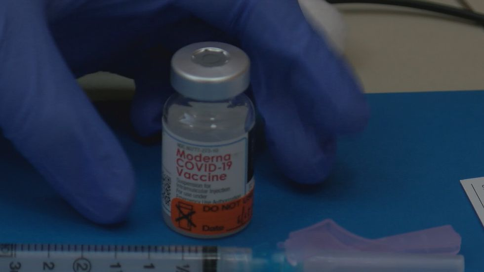Moderna Covid-19 Vaccine with the label visible before the doctor picks up the vile. Jan. 16th,...