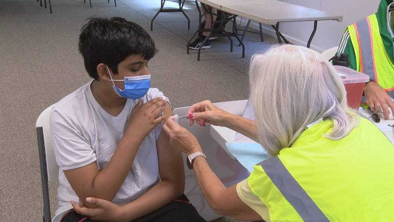 A youth in Louisville gets vaccinated