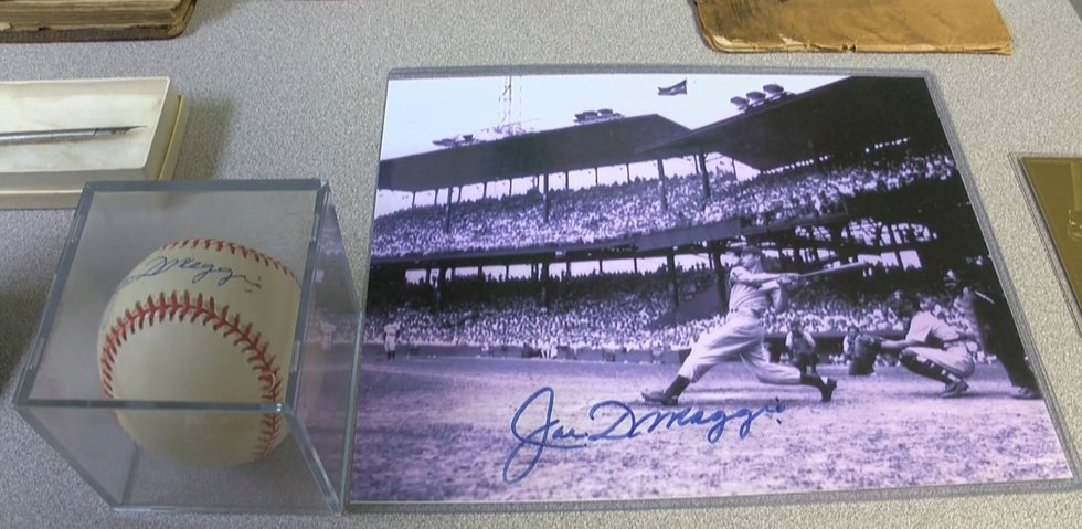 An autographed Joe Dimaggio photo and baseball sit on display in the Kentucky unclaimed...