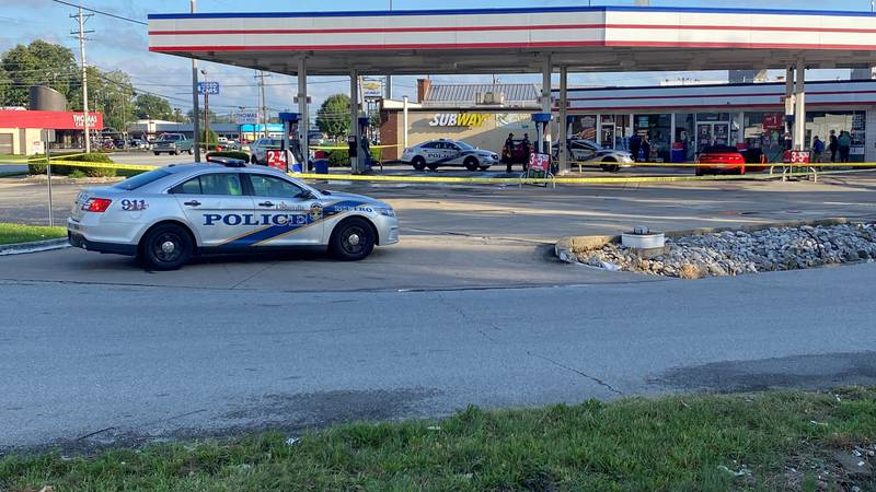 A WAVE3 News photographer picture shows the shooting scene in the parking lot at Thornton's