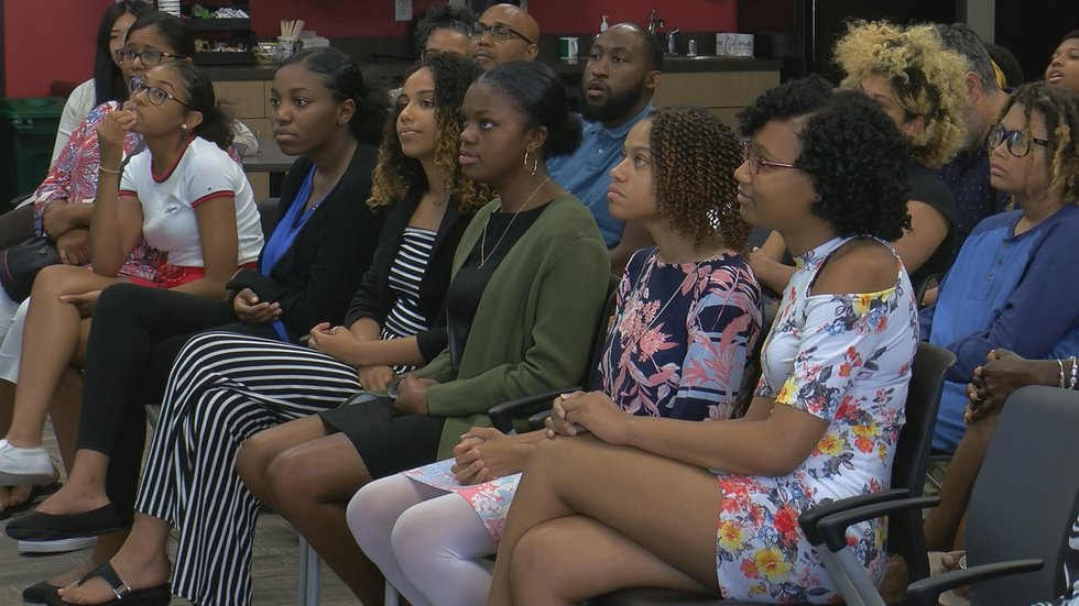 The group of young women worked on their website design and coding at Empowered Inc throughout...