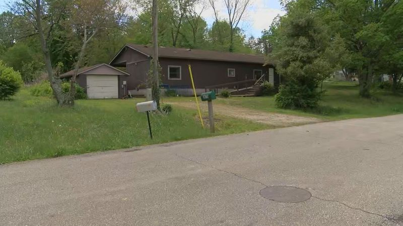 One woman died and six other people living in this Lexington, Indiana home were treated for...