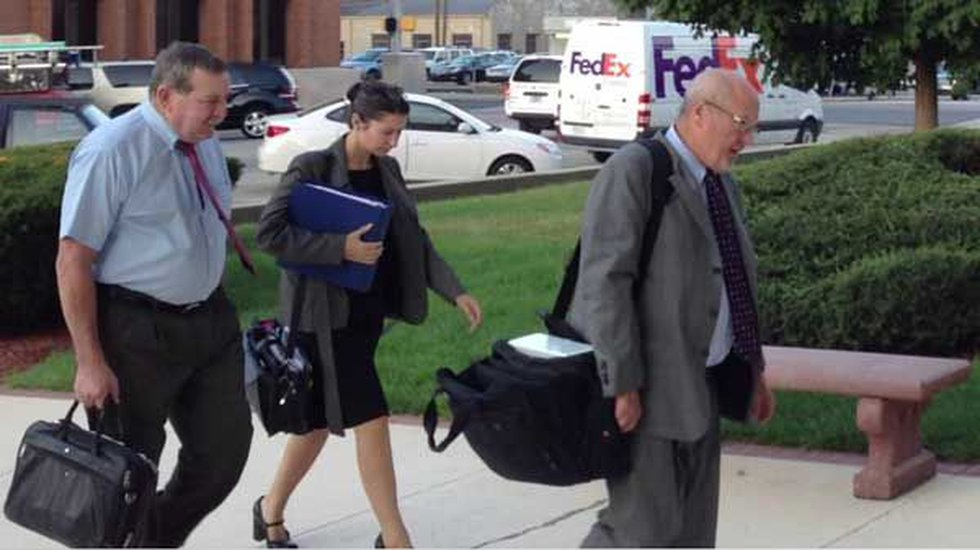 Defense counsel Richard Kammen and members of the Camm defense team arrive.
