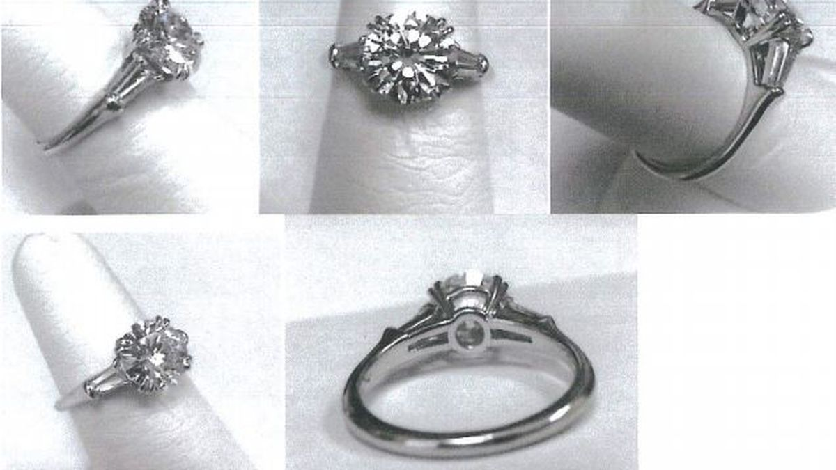Lee and Scott Davis each were indicted on a felony charge involving this $54,000 ring.