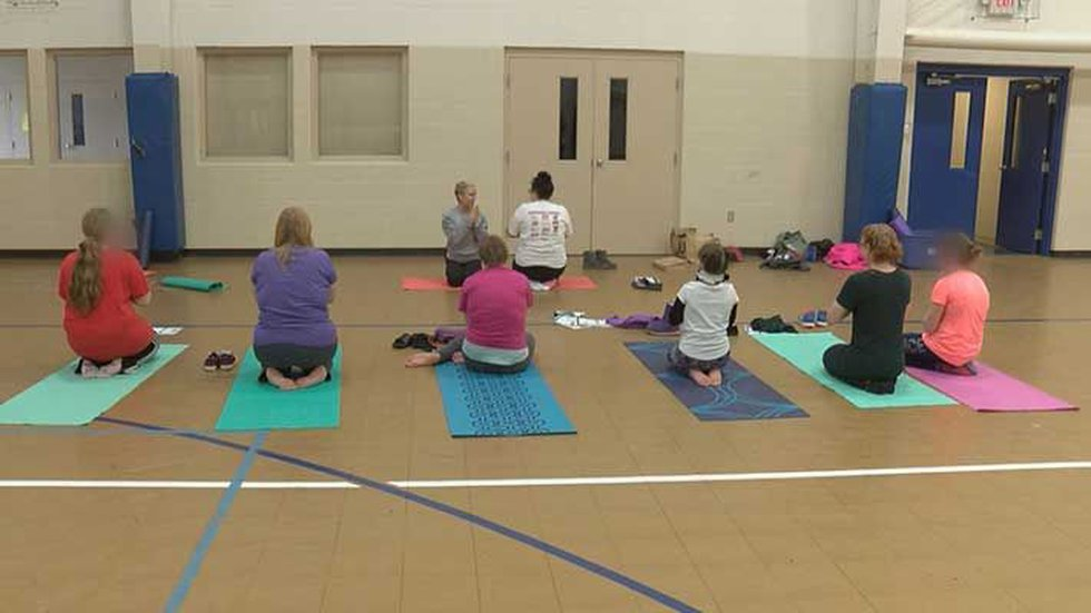 The girls who take her yoga class every week are building a connection with her and finding...