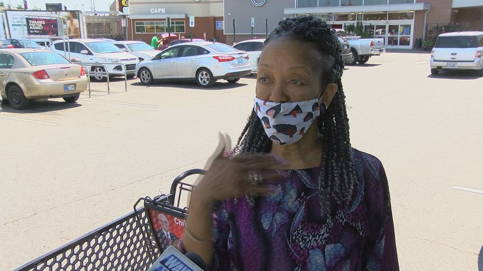 Although the requirement has been lifted, Debra Walton said she plans to continue to wear a...