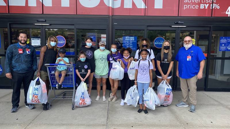 Racing Louisville and Academy Sports team up to give children a back to school shopping spree