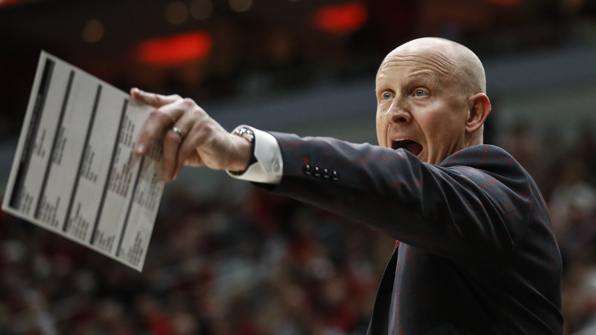 Louisville head coach Chris Mack yells to his players during the second half an NCAA college...