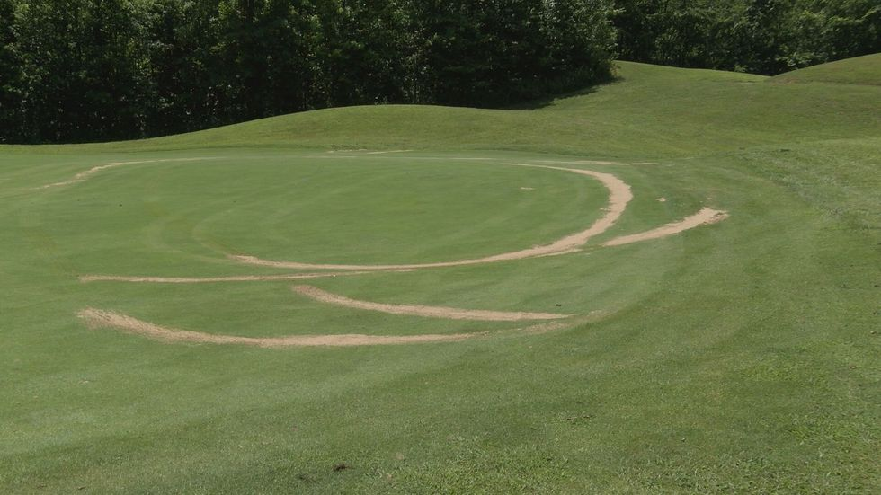 Course managers believe the damage  happened between 3 a.m. and 6 a.m. when someone drove a car...