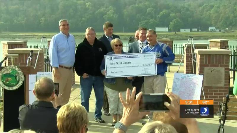 Governor Eric Holcomb was in Madison, Indiana Thursday, handing out checks that will provide...