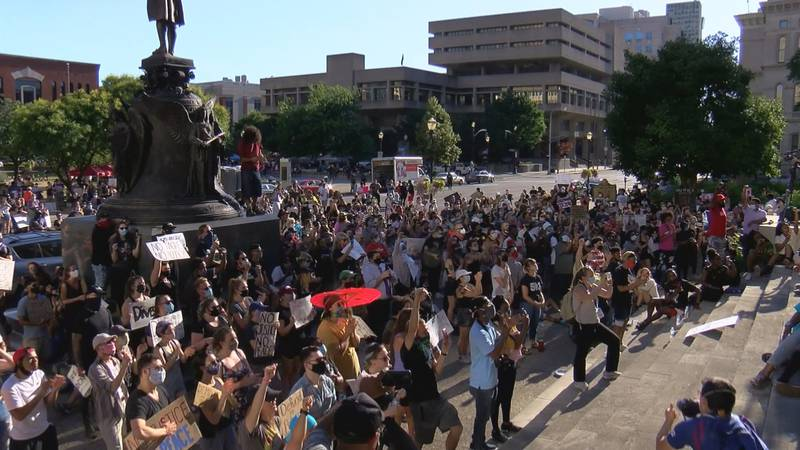 Hundreds took part in a rally at Louisville Metro Hall calling for an end racial injustice.