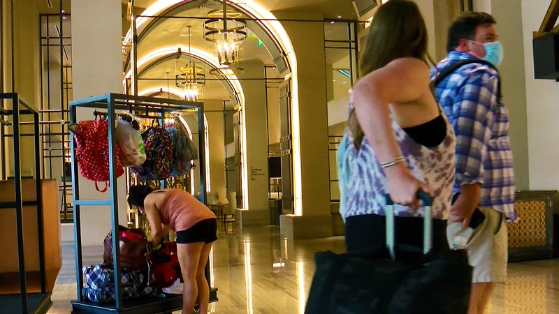 Hotel guests enter the The Omni Louisville lobby during the COVID pandemic.