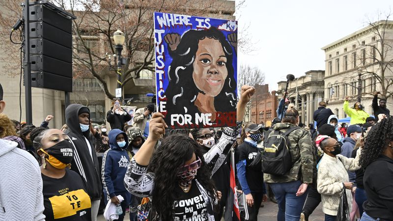 FILE - In this March 13, 2021 file photo, a protester holds up a painting of Breonna Taylor...