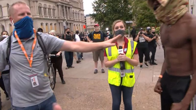WAVE 3 News reporter Kaitlin Rust and photographer James Dobson had to be escorted away and...