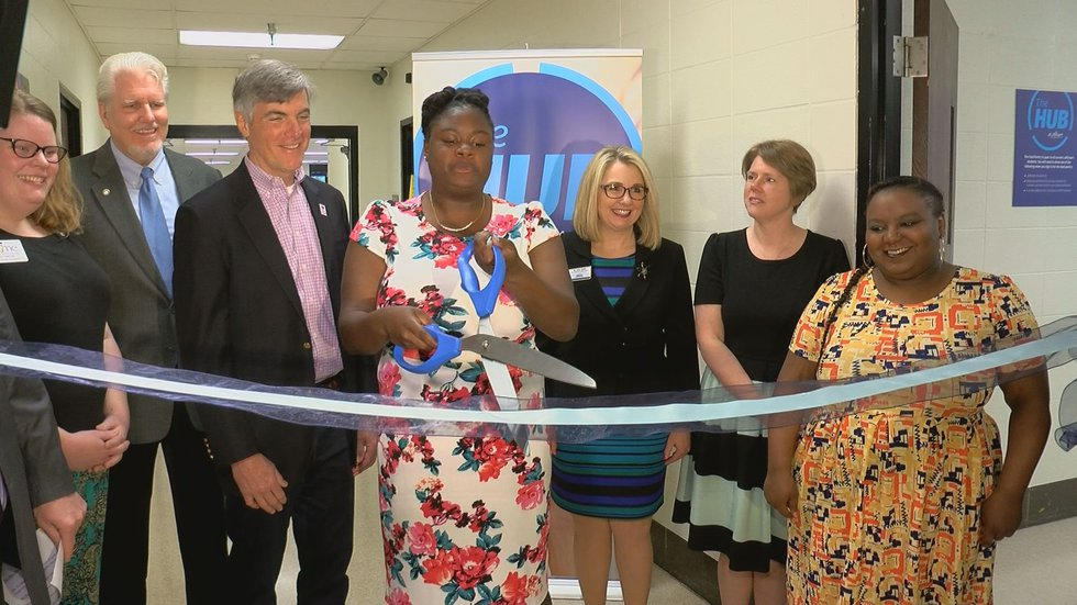 Shalaila Mayes, a student at Jefferson Community and Technical College, cut the ribbon to open...