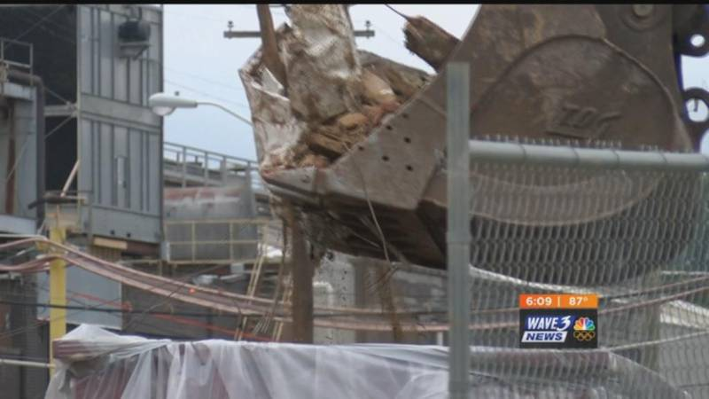 Clean up at collapsed building site begins