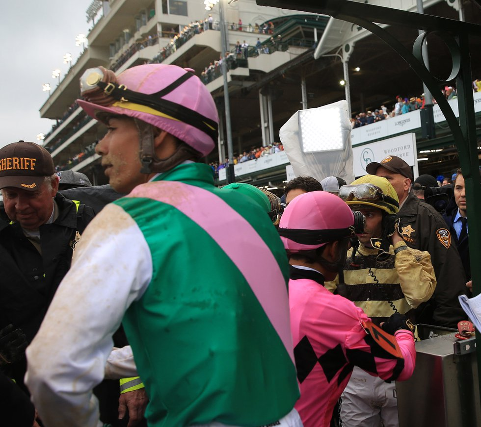 Country House jockey Flavien Prat (far right), speaks to officials during the inquiry following...