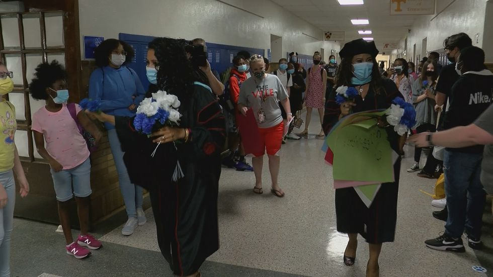 Students lined the halls of the school to cheer the women on.